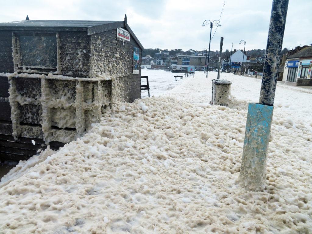 Sea foam on the pavement