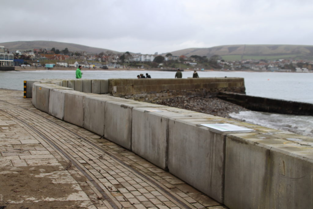 Concrete sea defence blocks back in position