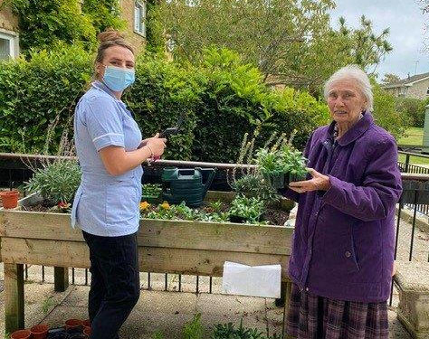 Gainsborough Care Home resident Barbara and care worker Louisa
