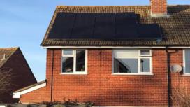 Black solar panels on roof