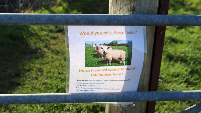 Poster about plans to build 150 homes