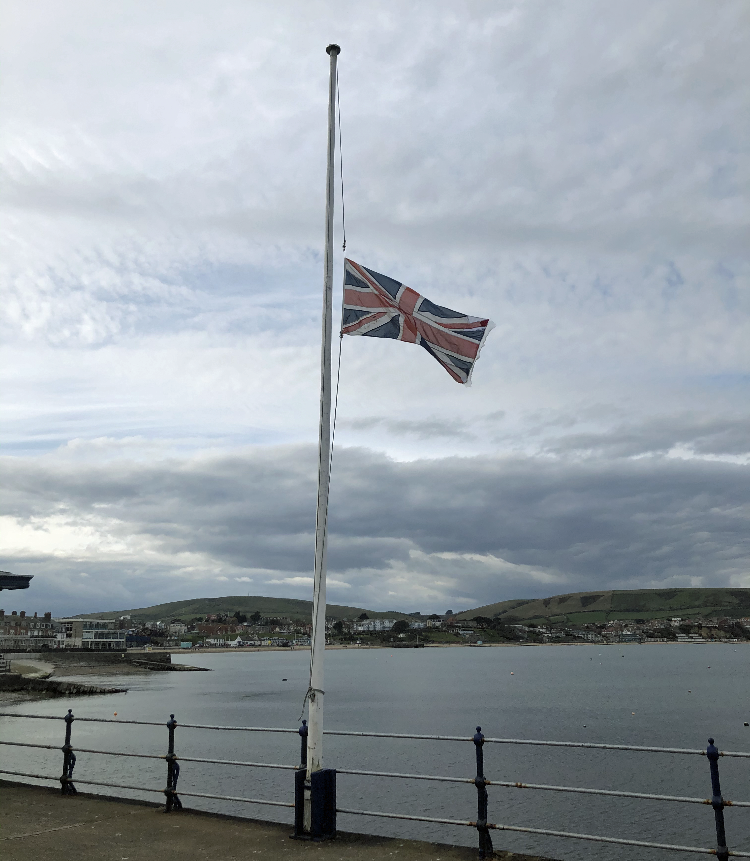 Flag at half mast at Swanage Pier