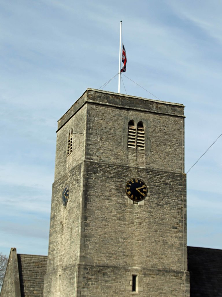 St Mary's Church tower with Union Flag at half mast.
