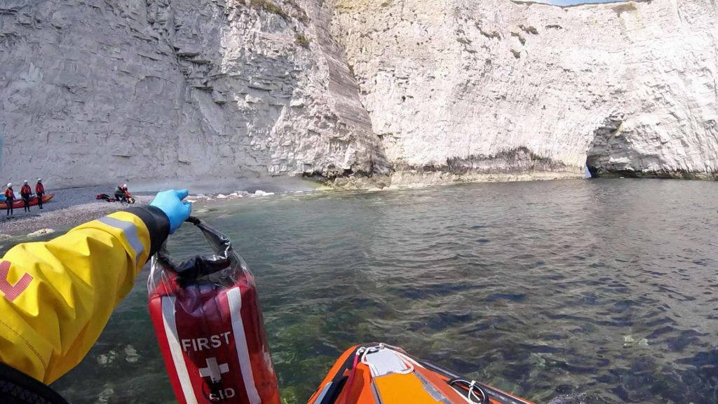 RNLI arriving at Old Harry Rocks to help man rescued by kayakers