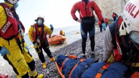 Man on stretcher being rescued by RNLI
