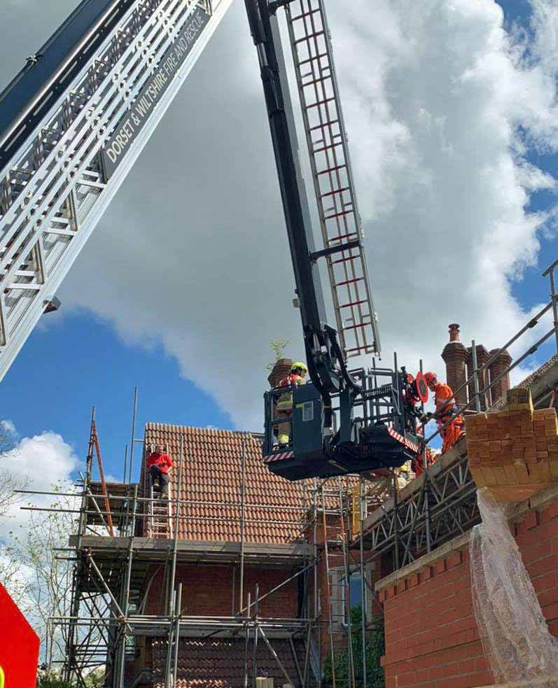 Roofer rescued from roof