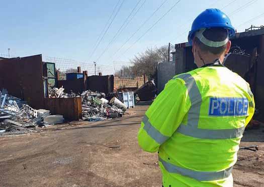 Police officer at Scrap metal yard