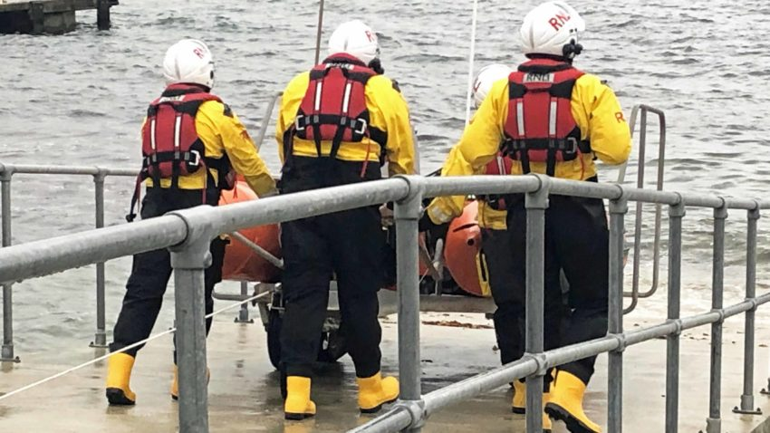 Swanage RNLI Lifeboat crew with the inshore lifeboat