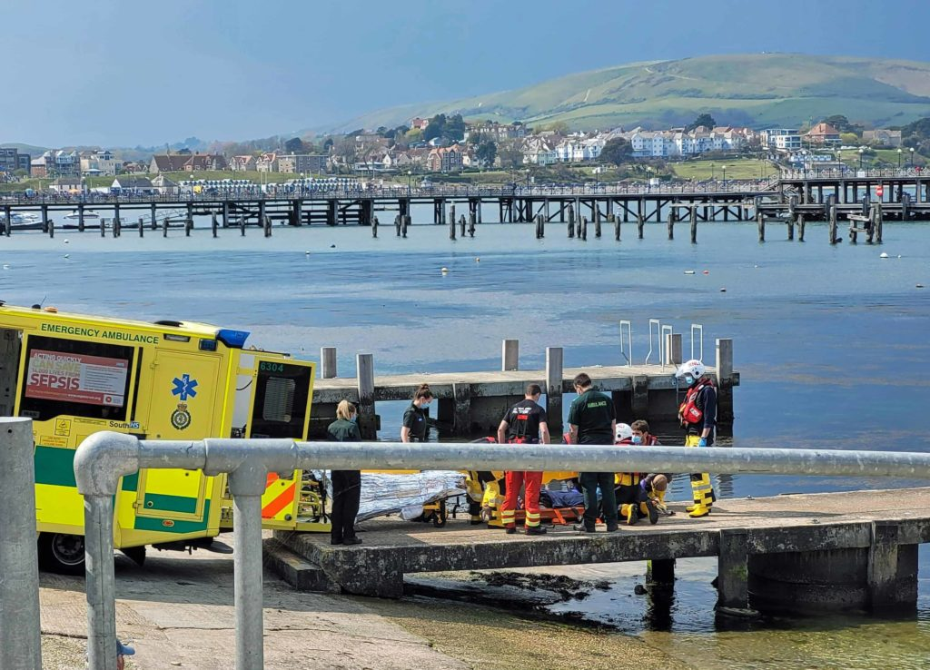 Injured man transferred from lifeboat into an ambulance