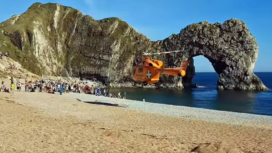 Air ambulance takes man to hospital after jumping off Durdle Door