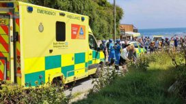Coastguard, ambulance car and ambulance at Lulworth