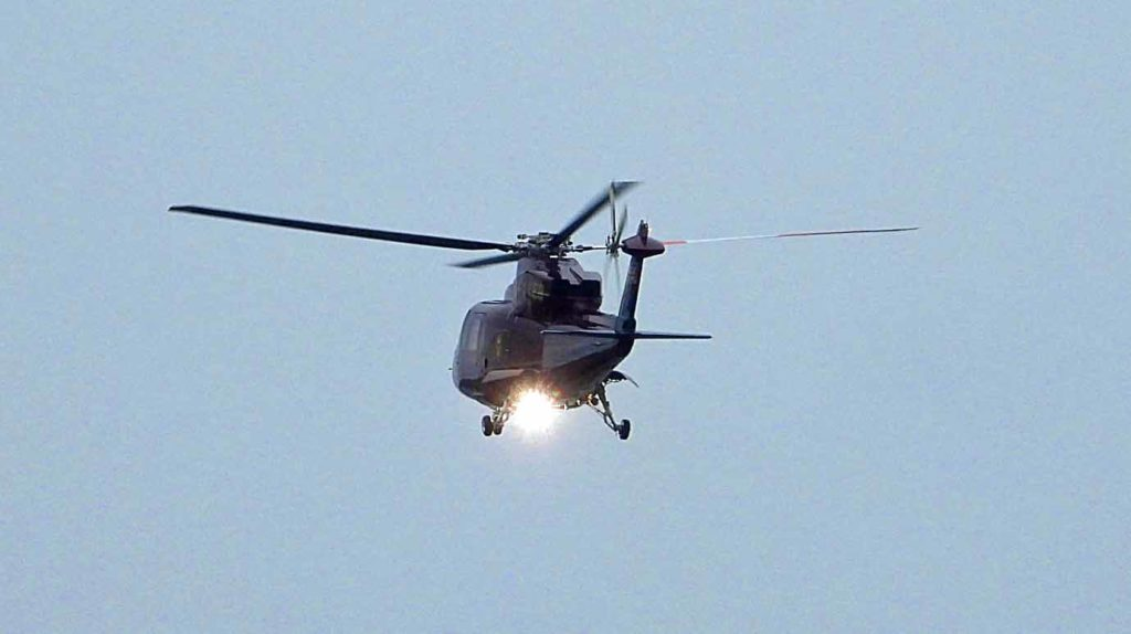Helicopter leaving Swanage with Princess Royal