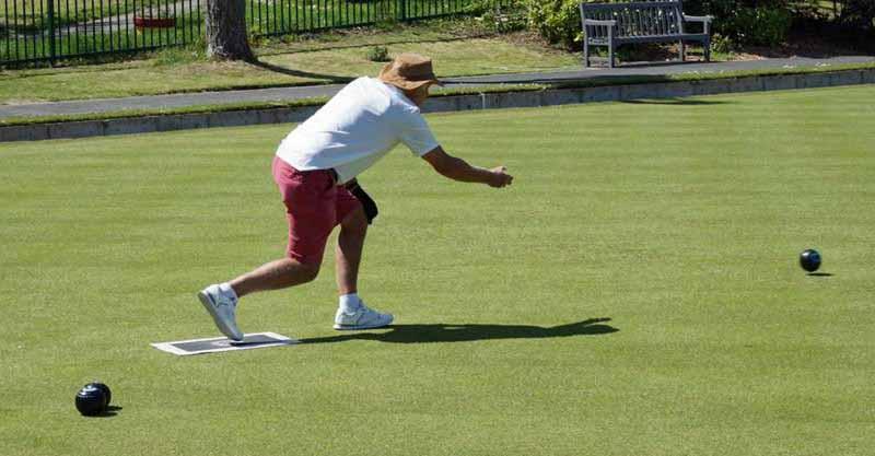 Man playing bowls at Swanage Bowling Club
