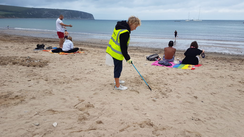 Litter picker on Swanage beach