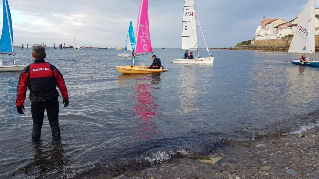 Dinghies return to shore