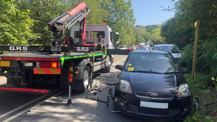 Car being removed by tow truck from Ferry Road in Studland (