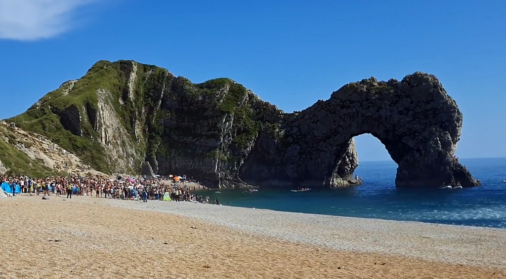 Coastguard helicopter rescue at a packed beach at Durdle Door