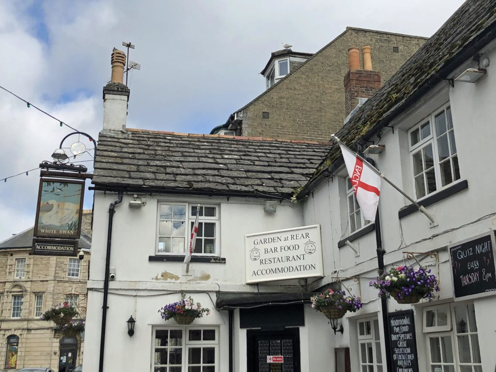 England flags flying from building in Swanage