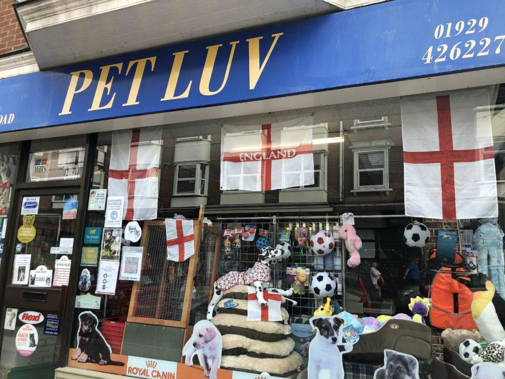 England flags in Pet shop window