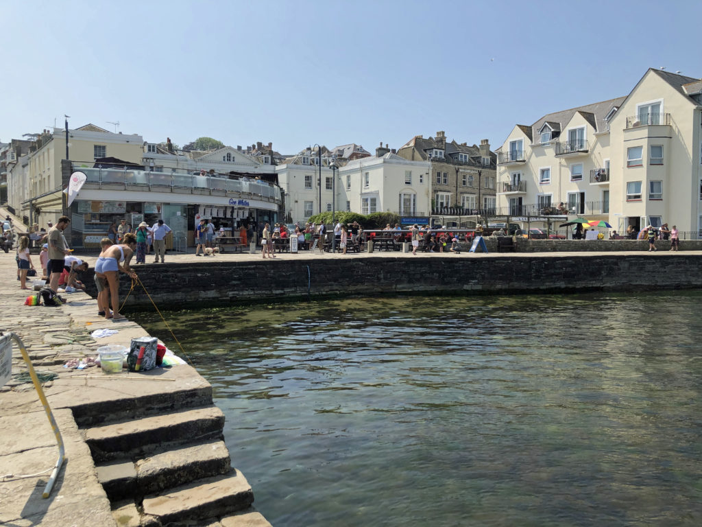 The stone quay with visitors queuing for refreshments at Gee Whites