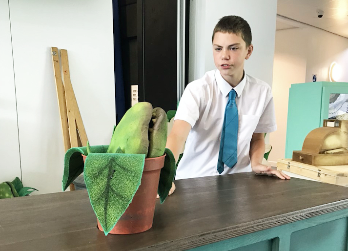 School child rehearses Little Shop of Horrors