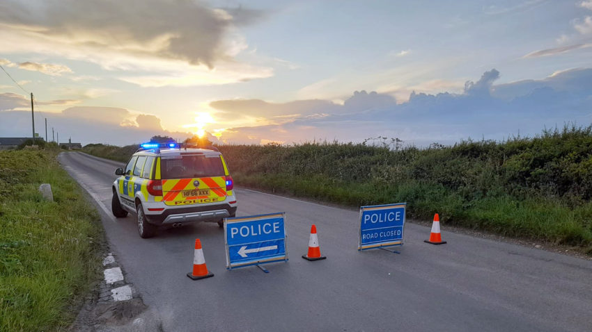 Police close road after car collision near Kingston