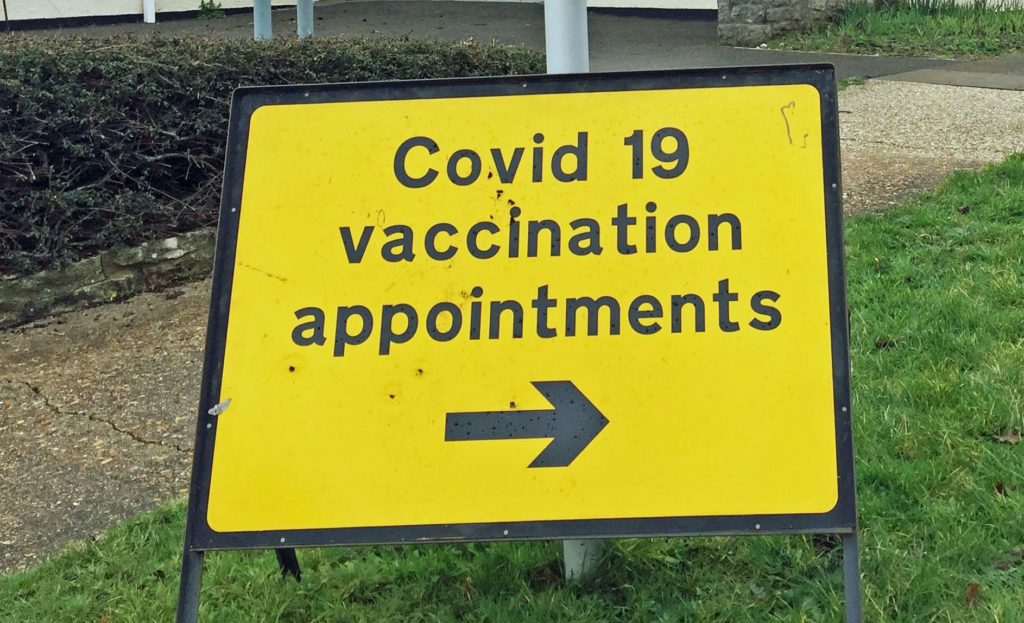 Covid vaccination sign