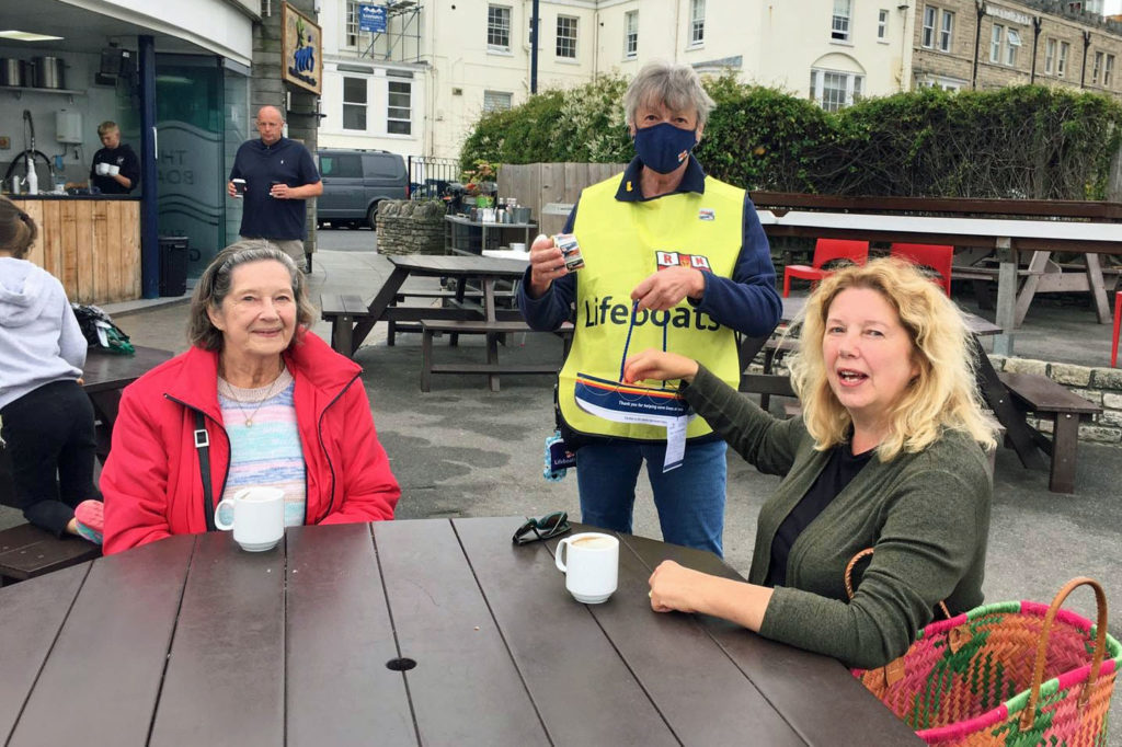 Swanage Lifeboat week flag day collector gets given a donation