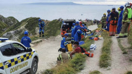 Teenagers being rescued from cliff at Durdle Door