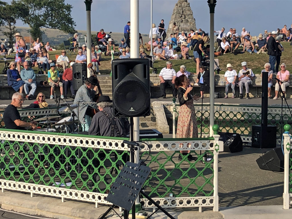 Feverstreet performing at Swanage Bandstand