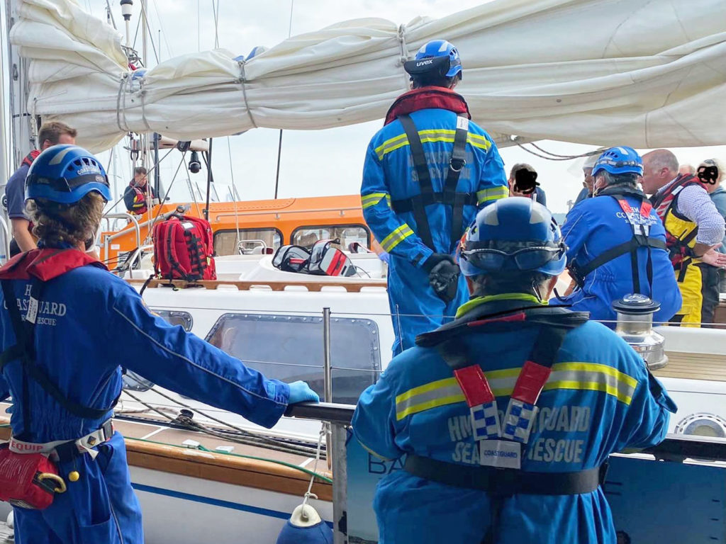 Coastguard at Poole Quay rescuing injured woman