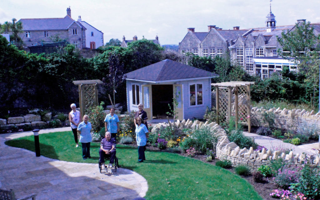 Swanage Hospital staff with a patient in the new garden