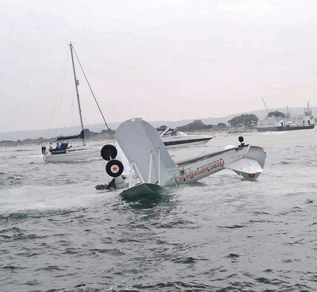 wingwalker plane half submerged in the sea