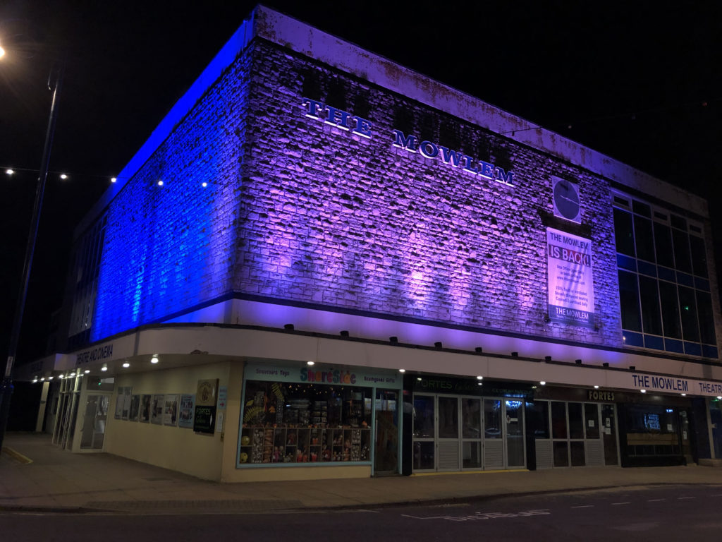 The Mowlem lit up in purple and blue lights