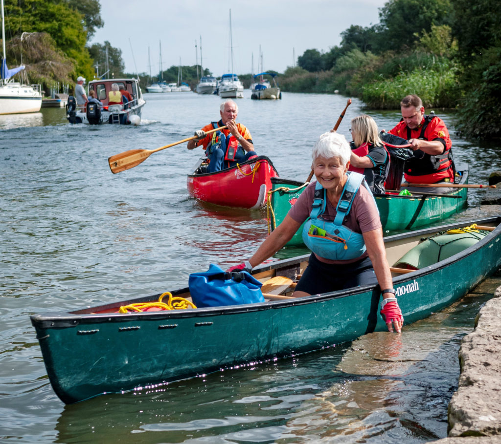 litter pickers in canoes