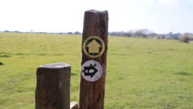 Footpath markers on wooden stile
